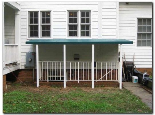 Covering The Steps To Walk Down Basement Solves Many Wet Basement Problems.  An Awning Over