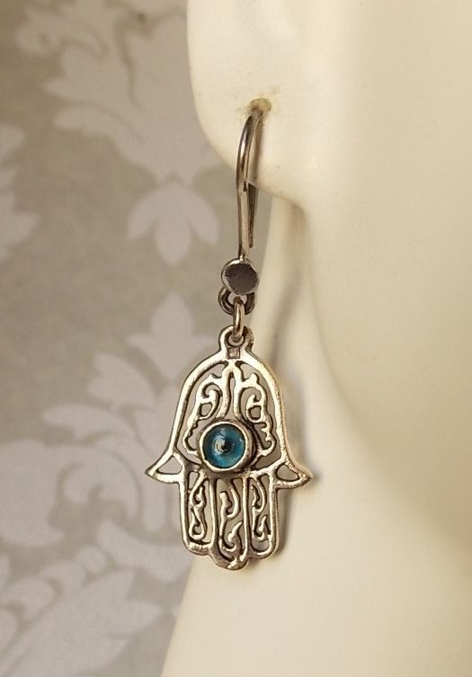 7c5420620 Metal: Solid .800 sterling silver and with a blue glass eye, made in Egypt.  Size: 1.75