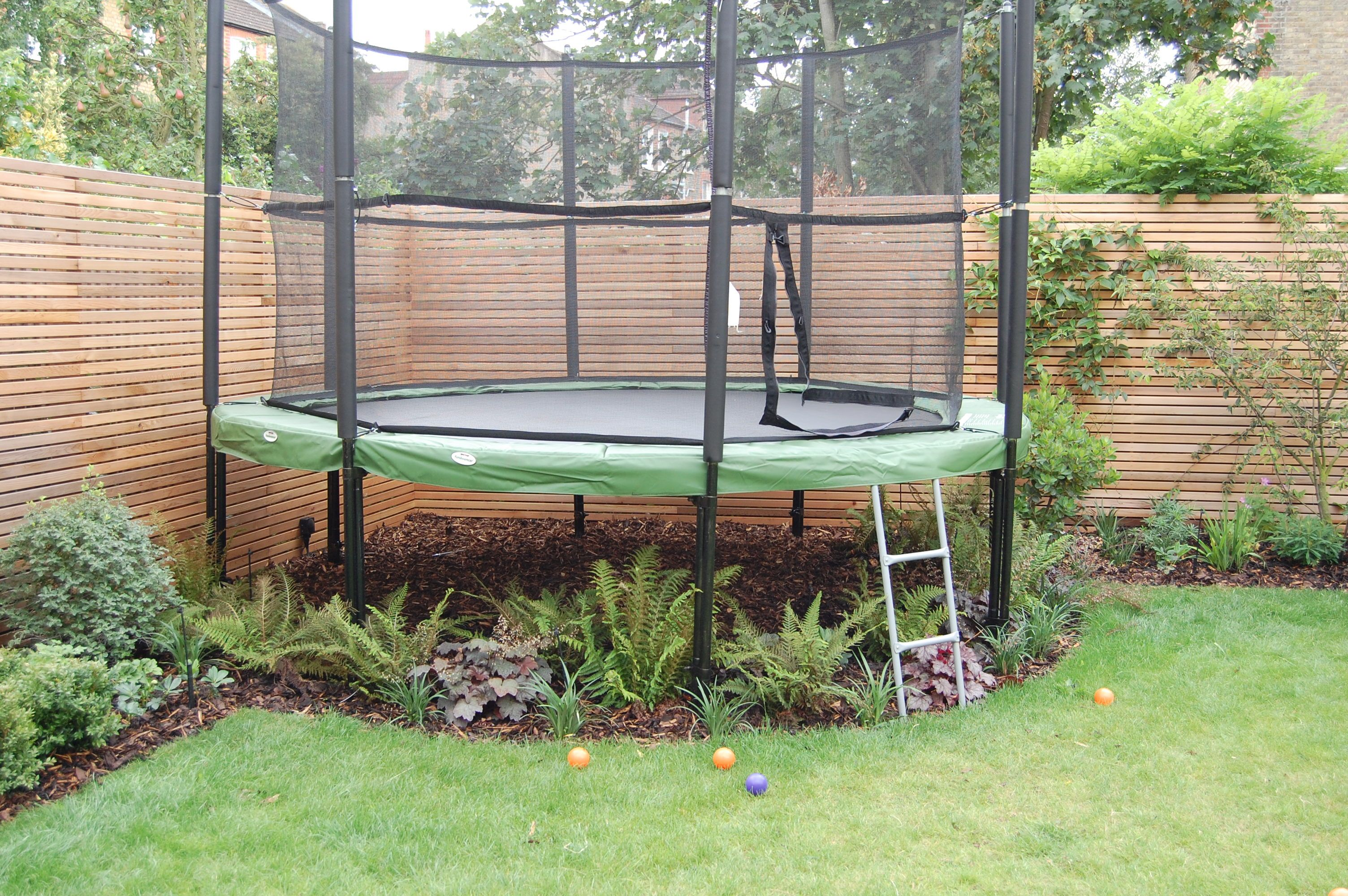 Shelley hugh jones garden design underplanted trampoline for Garden sectioning ideas