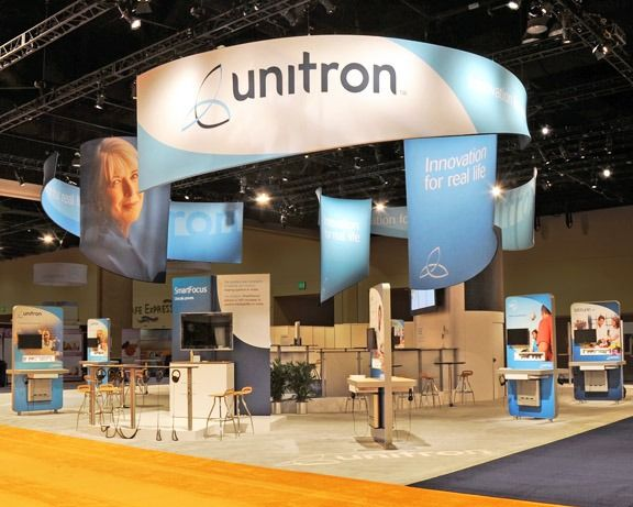 Exhibition Booth Structure : Using hanging banners for signage keeps space open below