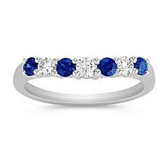 his vibrant and sparkling wedding band features three round diamonds, at approximately .21 carat TW, and four round sapphires, at approximately .32 carat TW. These glorious gems are set in quality 14 karat white gold, and the total gem weight is approximately .53 carat.