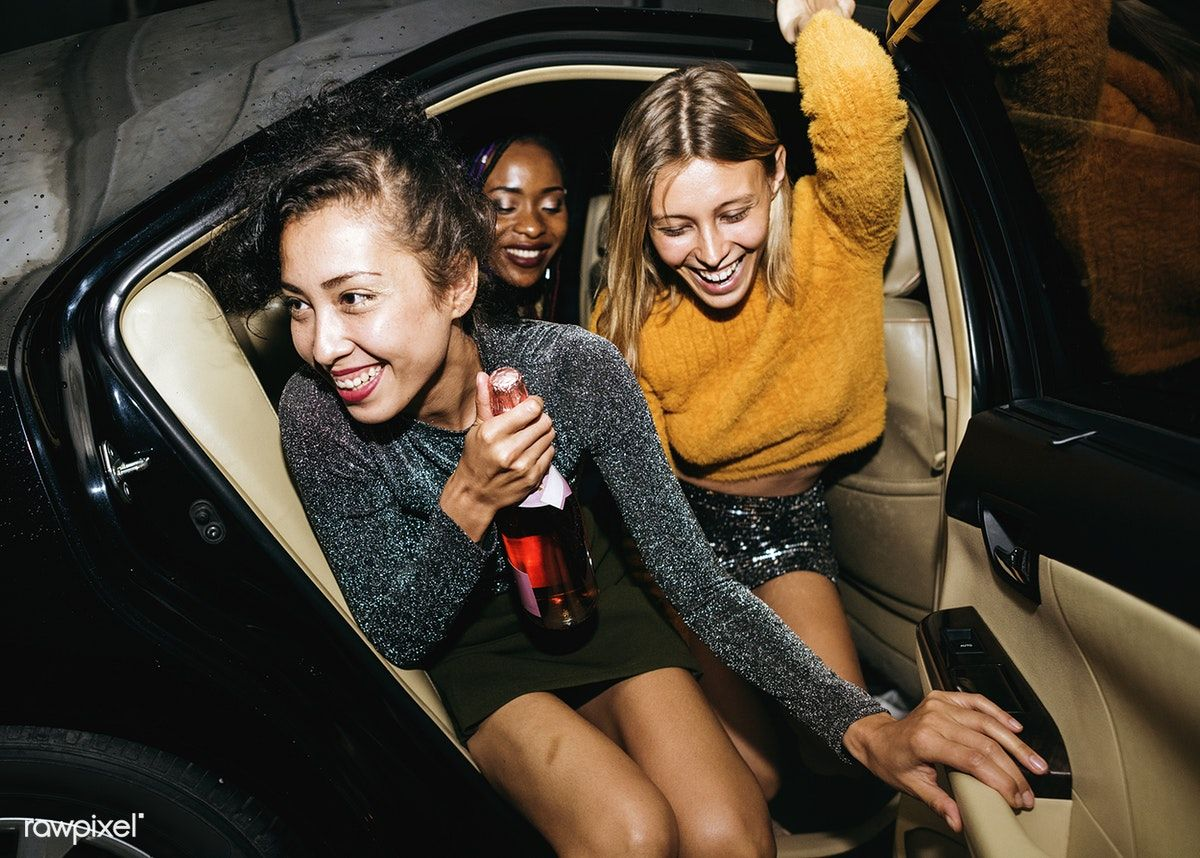 Download premium image of diverse women in a backseat of a
