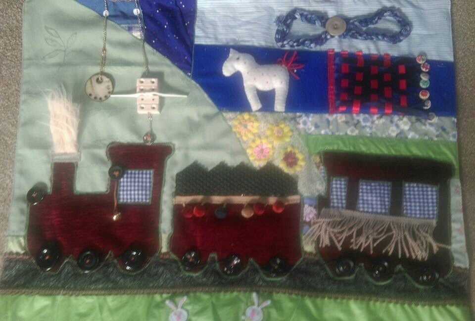 Another train using upholstery fabric, small plastic bits , a horse