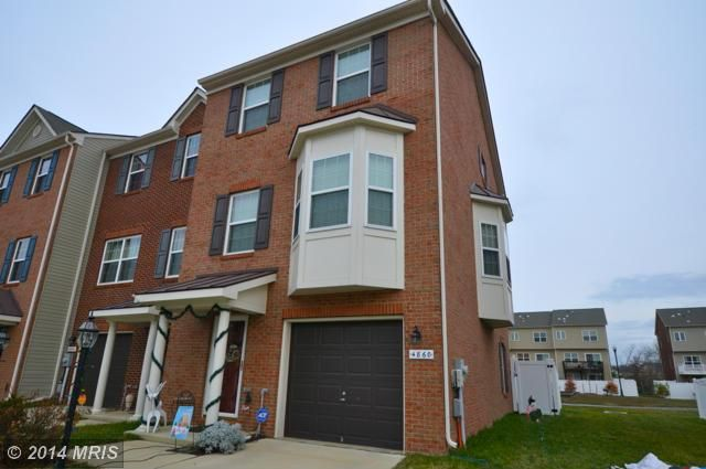 Gorgeous end unit townhouse! Large kitchen with center island and table space. Kitchen has sliding glass door to back deck, Perfect for entertaining family and friends!