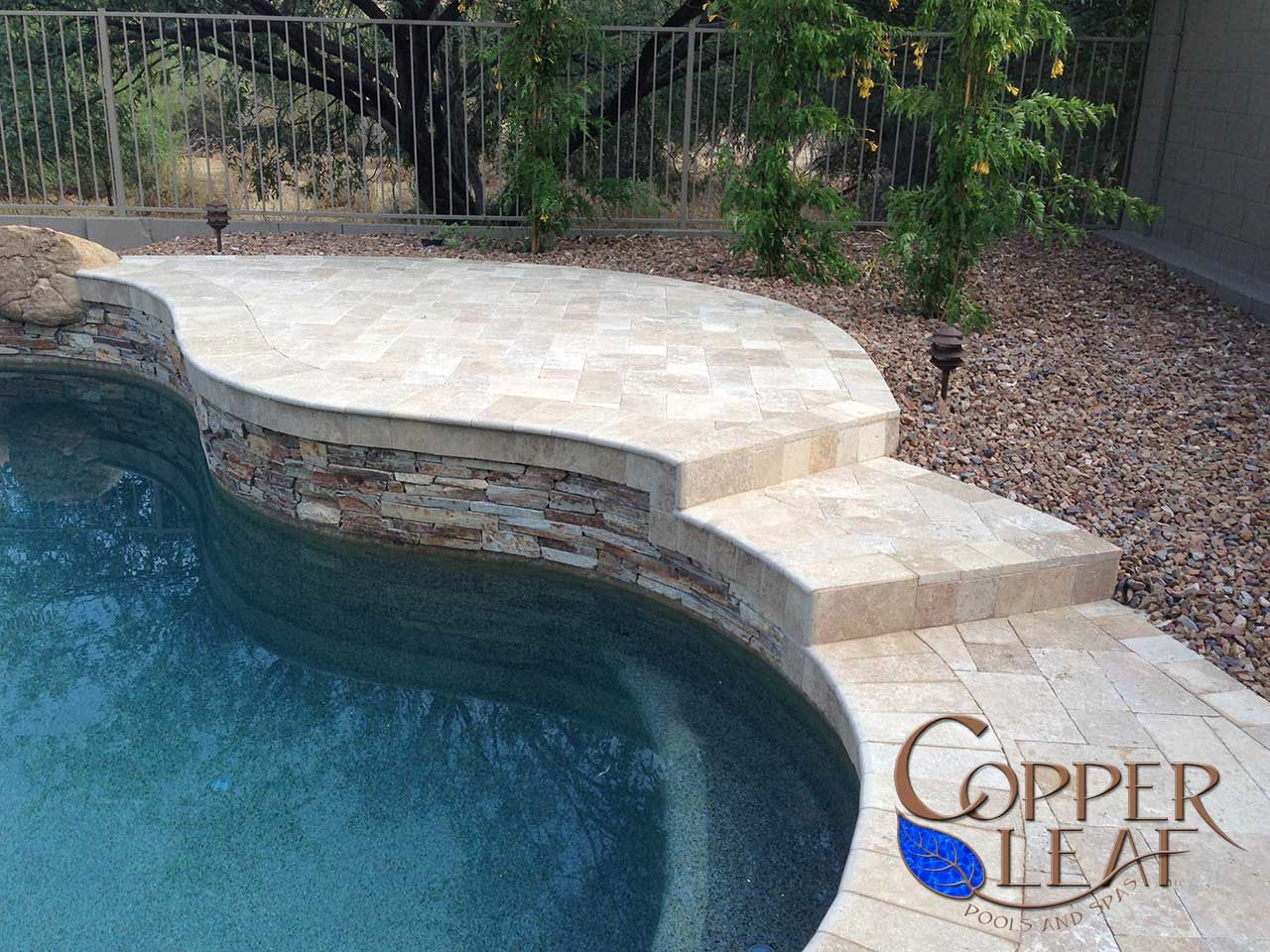 Raised water feature mt moriah ledgestone on water for Swimming pool water features
