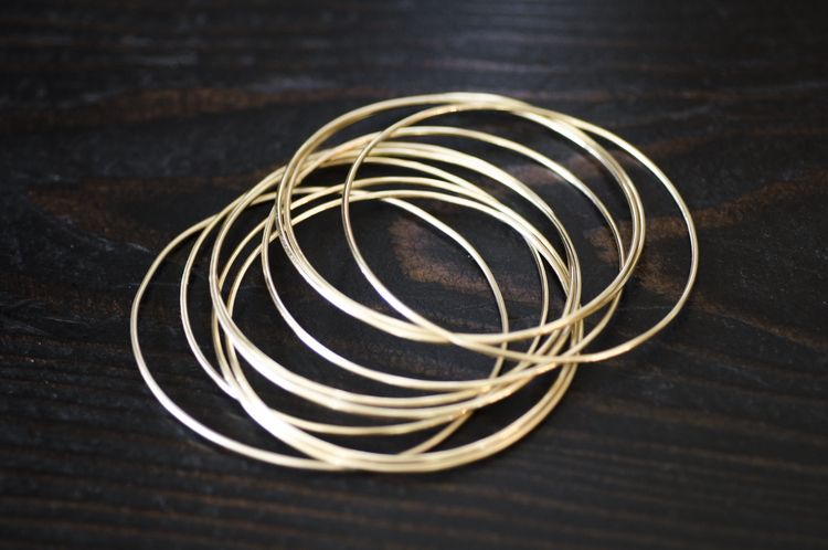 b880d7dc8a38d Original gold stacking bracelet from Evermore Co. A tradition started by a  family member or friend of a bride and continued by her husband each year.