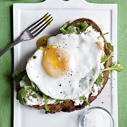 Open-Faced Sandwich with Ricotta, Arugula, and Fried Egg.