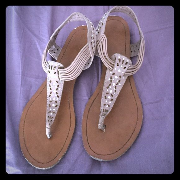 Nude jeweled sandals Steve Madden sandals! I'm a 7.5 and these still fit me as a 6.5. The back and ends of the shoe are scarred up but the bottoms still have their grooves and the jeweled material is still in good shape Steve Madden Shoes