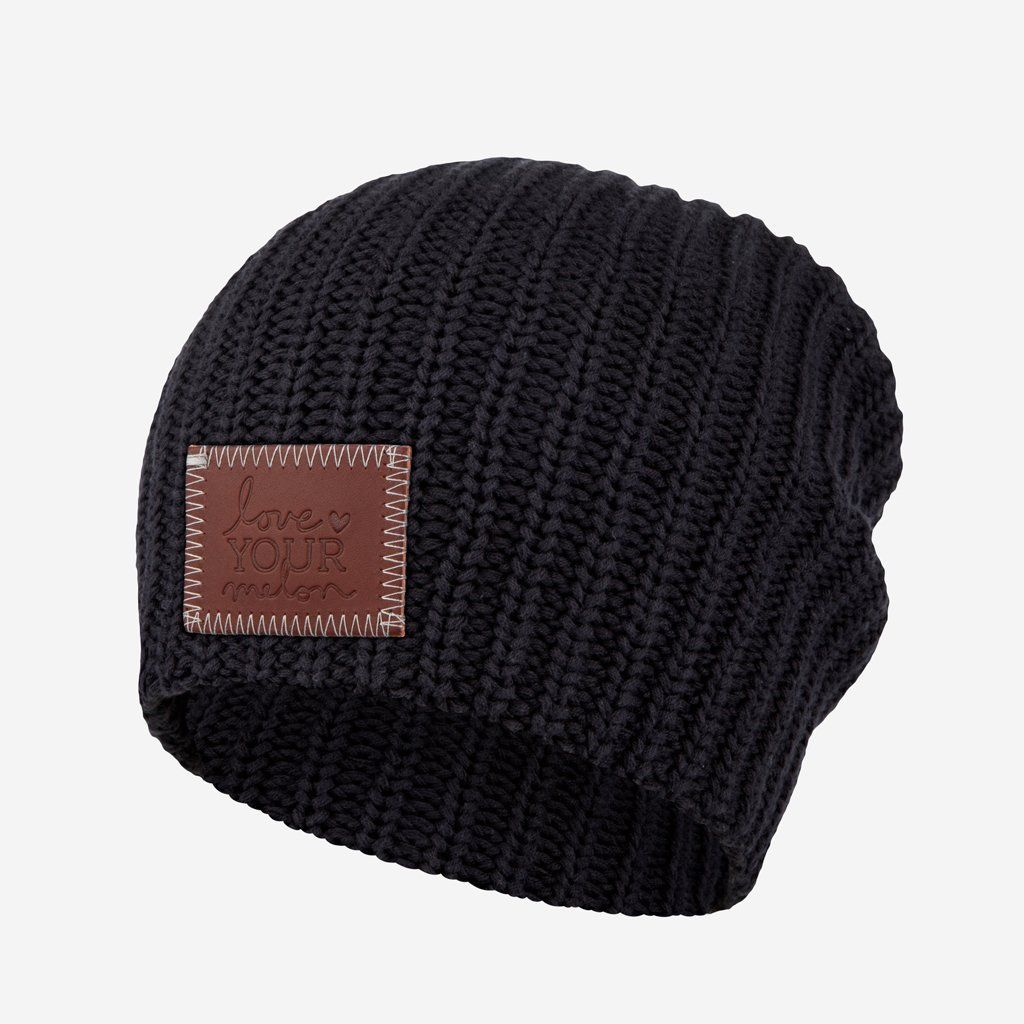 0e00ed204a5ba This beanie is knit out of 100% cotton yarn in a black color and features a  leather patch debossed with the Love Your Melon logo.