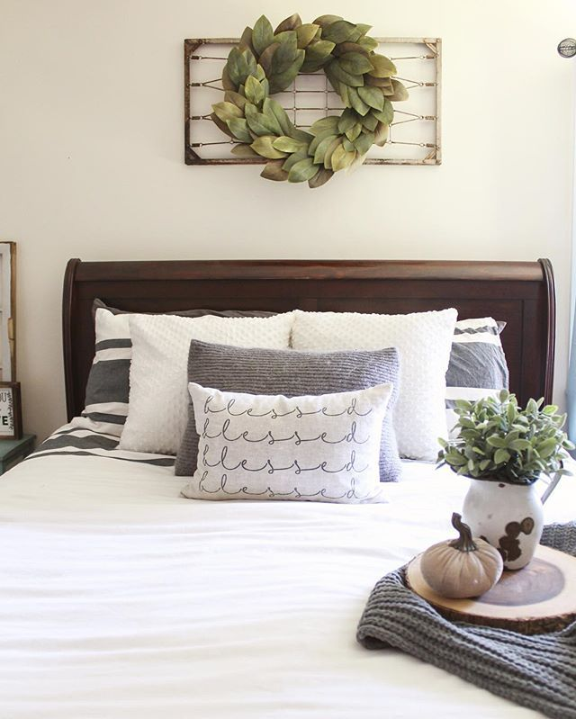 An out of the box idea for above the bed hang an old wire bed spring with a wreath bedroom Master bedroom art above bed