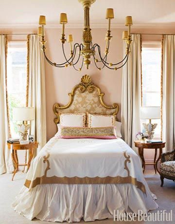 "This New Orleans master bedroom's feminine mystique starts with something old: an antique headboard designer Melissa Rufty found at Bush Antiques just after graduating from Tulane. ""It's so New Orleans, so sexy,"" she says. ""I imagine it's from some French hotel."" Bed linens reminiscent of Old Paris porcelains are by Leontine Linens.   - HouseBeautiful.com"