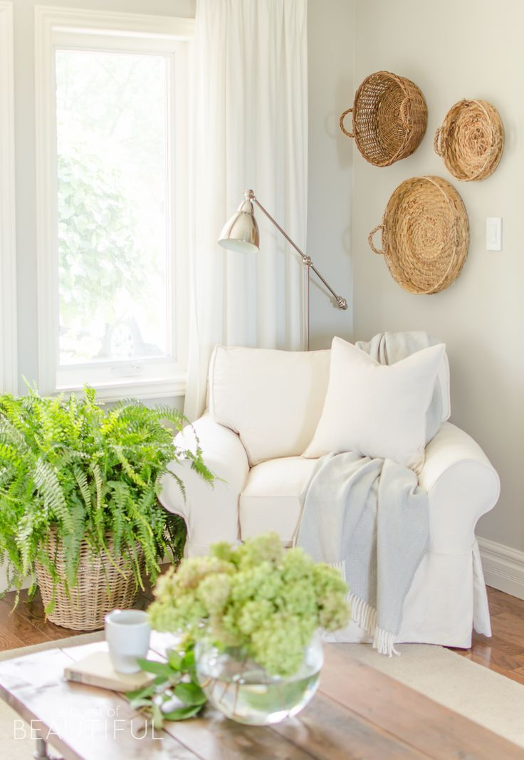 A White Slipcovered Sofa Looks Casual And Relaxed In This Charming  Farmhouseu2026