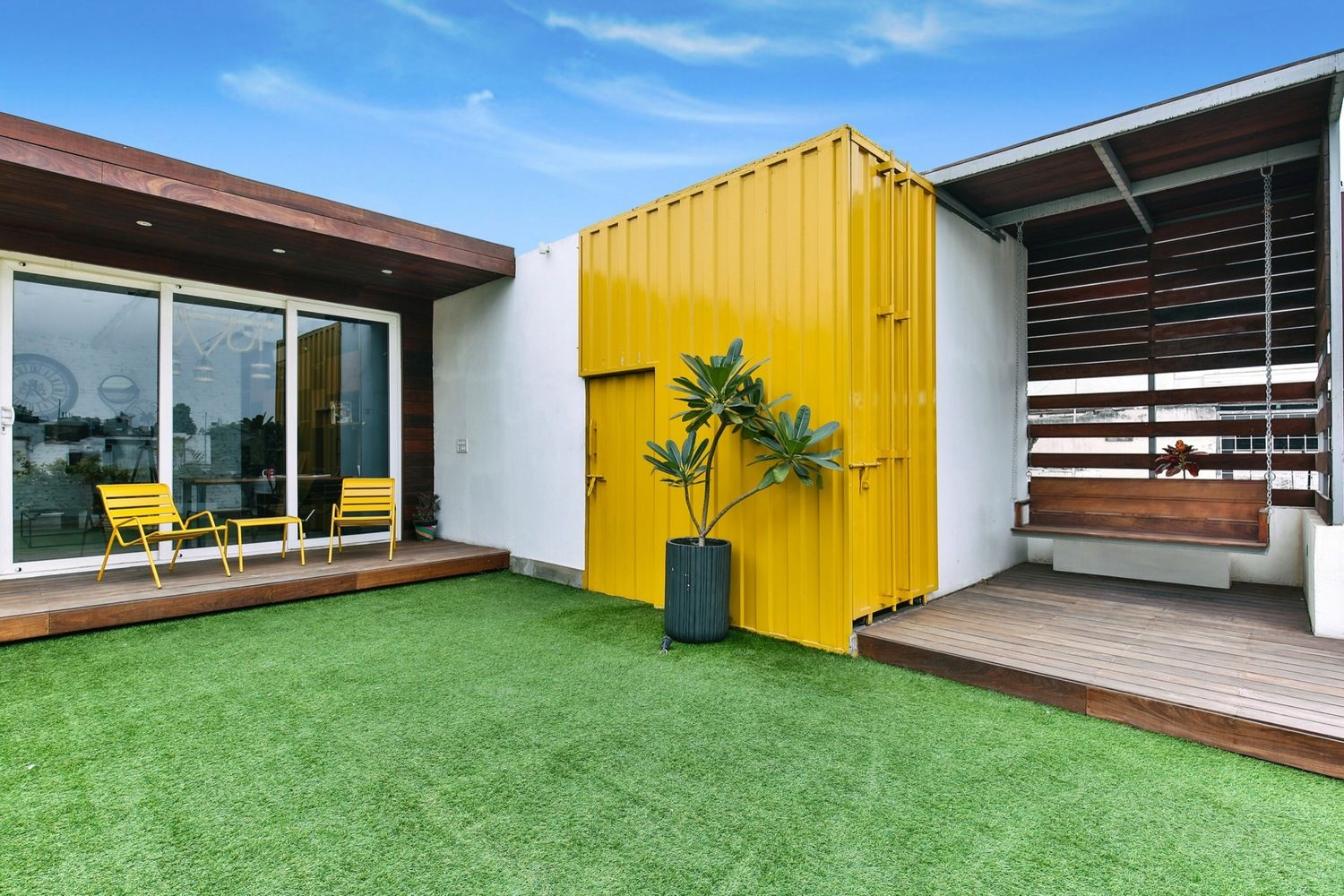 Roof top house constructed with used shipping containers gallery of studio for two wood also courtyard pinterest rh
