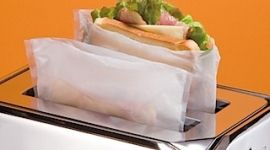Toaster bags! You just put your sandwich inside one and pop it in the toaster for a no mess hot melty toasted sandwich or pizza!