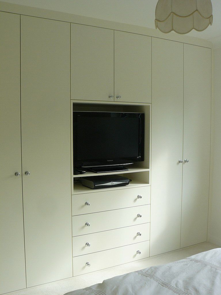 Master bedroom wall built ins add lots of closet space and drawers clean coat of paint new Master bedroom tv wall unit