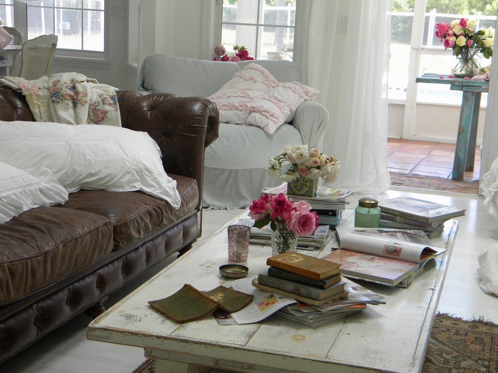 Living Room Decor Ideas Brown Leather Sofa use pale pink flowers with small vase on table, get two white