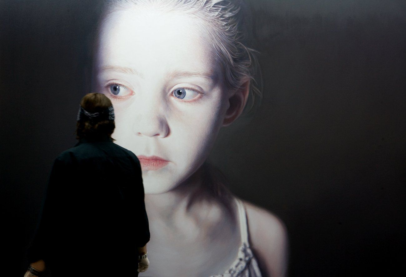 ...then you realise that this is a painting  http://www.gottfried-helnwein-child.com/works/murmur_of_the_innocents.html