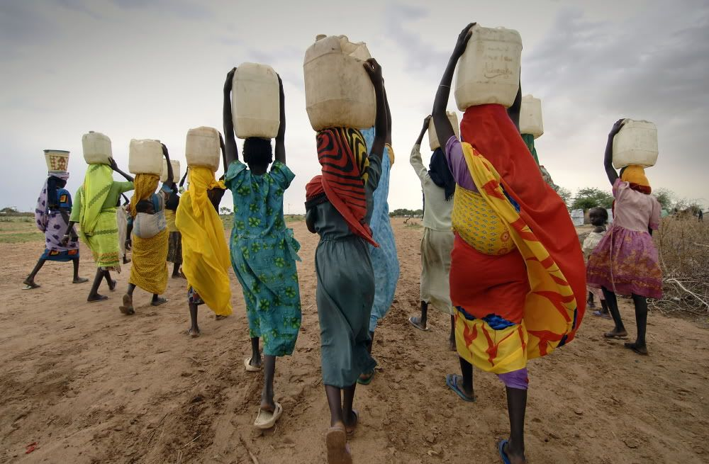 Image result for women carrying water