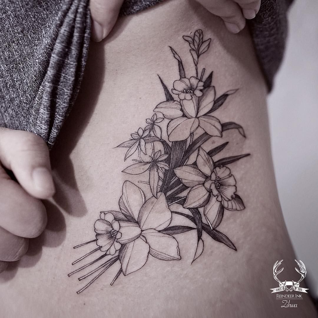 Daffodil Black And White Floral Tattoo On The Torso Reindeer Ink