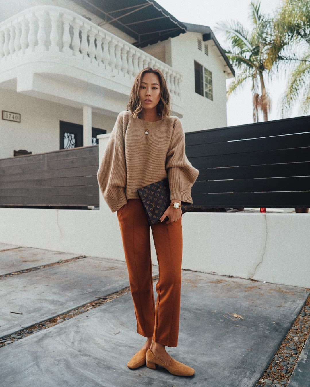 Boxy Camel Sweater+brick red pants+and mustard Suede Pumps+Louis Vuitton  clutch+necklace.