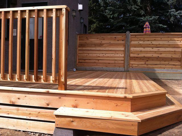 Custom calgary cedar deck and railing calgary decks by for Custom deck ideas