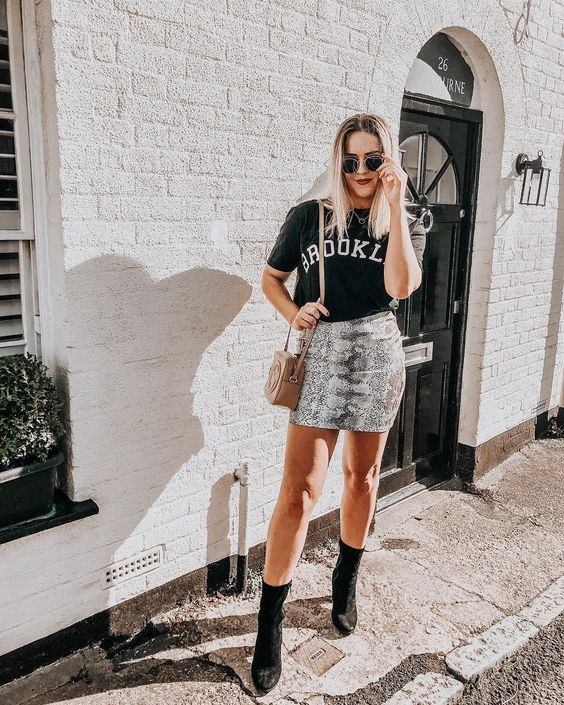 Make moves in this chic faux snakeskin beauty. Snakeskin print is a combination grey and black pattern.This skirt is a fitted mini skirt made to make bold moves. Zipper back closure. #wildrina #snakeskinskirt #fallstyle #falloutfit #fallstyle #teeshirtoutfit #cuteoutfit #casialoutfit #dressyoutfit #style #bloggerstyle  #animalprint #skirtoutfit #sweaterweather #cutefalloutfit #bloggeroutfit #bloggerstyle #springstyle #streetstyle #skirtoutfit #snakeskinoutfit