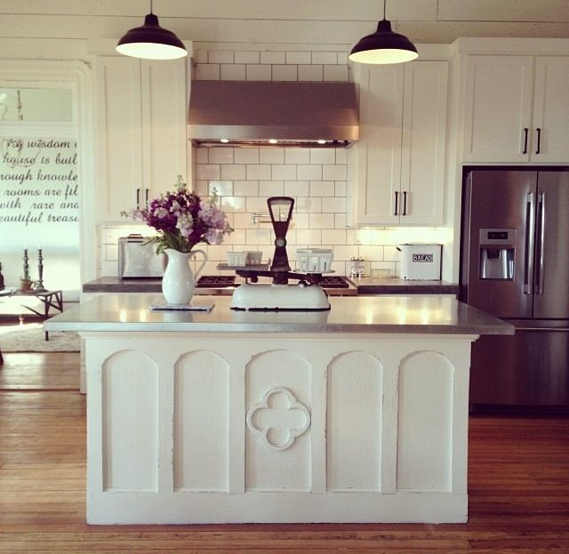 Love the white on white with the cement countertops. The island is ...