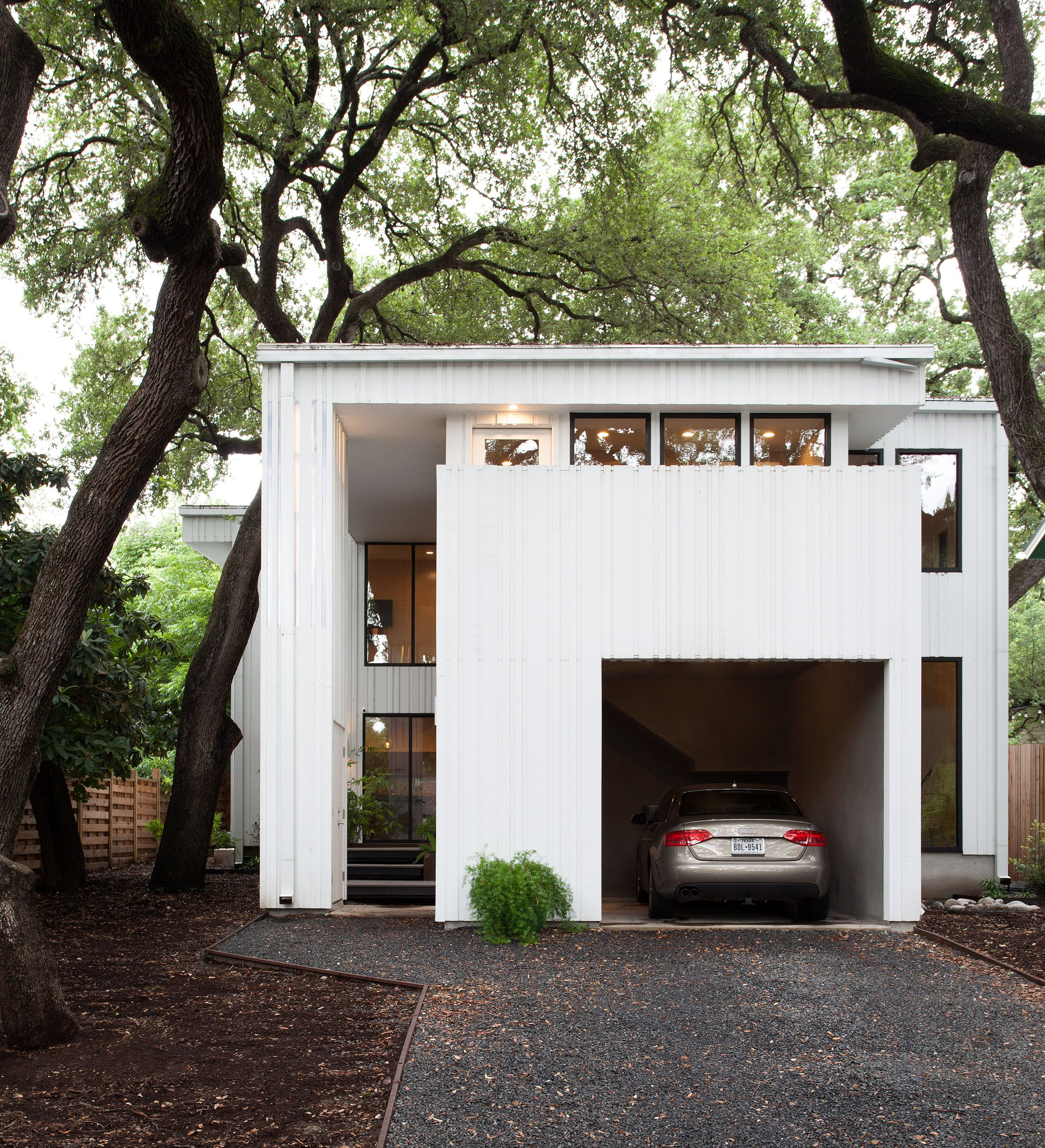 Vertical strips surround white Barcode House in Austin by Webber