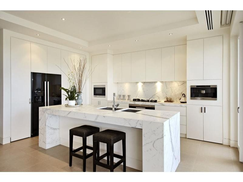 White Kitchen With Calcatta Wrapped Central Island | Inspiring
