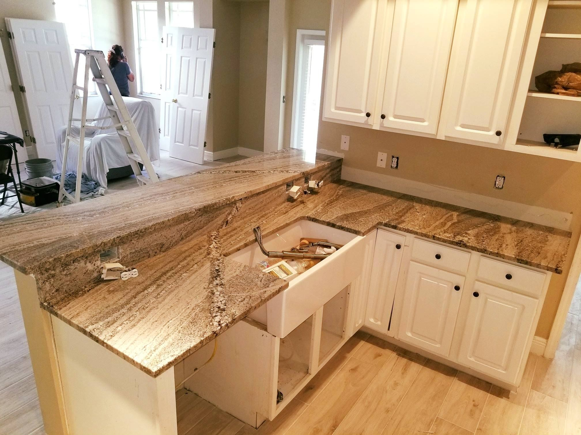 Amazing L Shaped Custom Made Kitchen Countertop Made By Using Mont Blue Color Granite Designed Polished And Installe Countertops Kitchen Countertops Kitchen