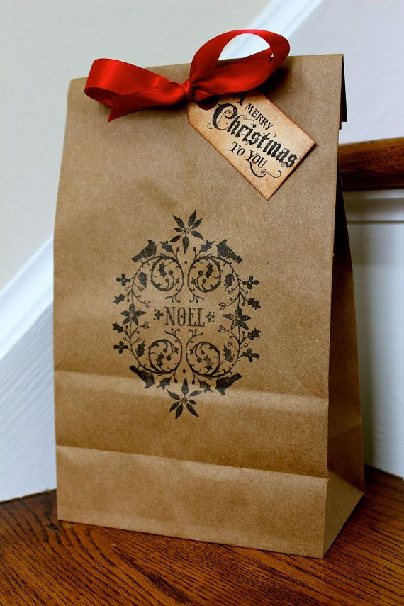 I bought a package of brown kraft bags (with handles).  I plan to lay snowflake stencils on top and spray with silver paint.  I will add a matching tag fastened with red ribbon and embellish with a rhinestone. :)