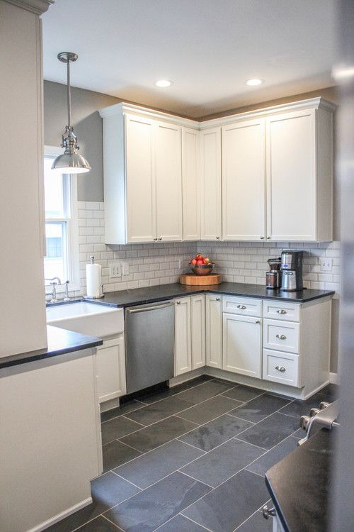Modern farmhouse kitchen gray tile floors white cabinets for Dark tile kitchen floor