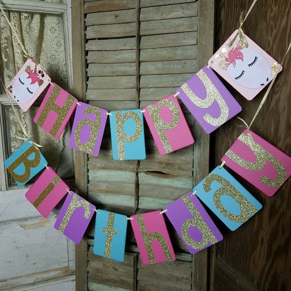 Unicorn Party Decor! This sweet handmade banner is perfect for your special Birthday celebration! This is a very sturdy banner that with proper care will last for many years of repeated use!! We have a matching cake banner and cupcake toppers in the shop!  • Crafted from 4 x 5.5 inch sturdy chipboard covered in colorful specialty papers, the edges are inked in coordinating color. • Gold glitter letters are approx 5.5 inches tall. • Unicorns accent each end of the top banner with gold glitter…