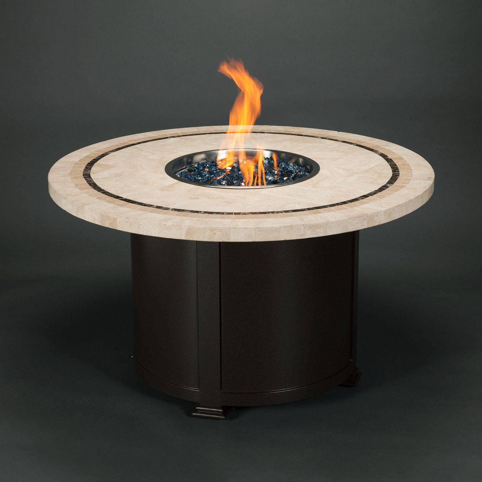 benner round fire table with beige travertine tile fire table