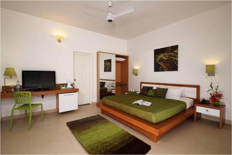 Deluxe room, Swiss County Munnar  -SAVIO and RUPA Interior Concepts Bangalore | professional interior design company Bangalore | Modern Interior Designers | Residential Interior Designs