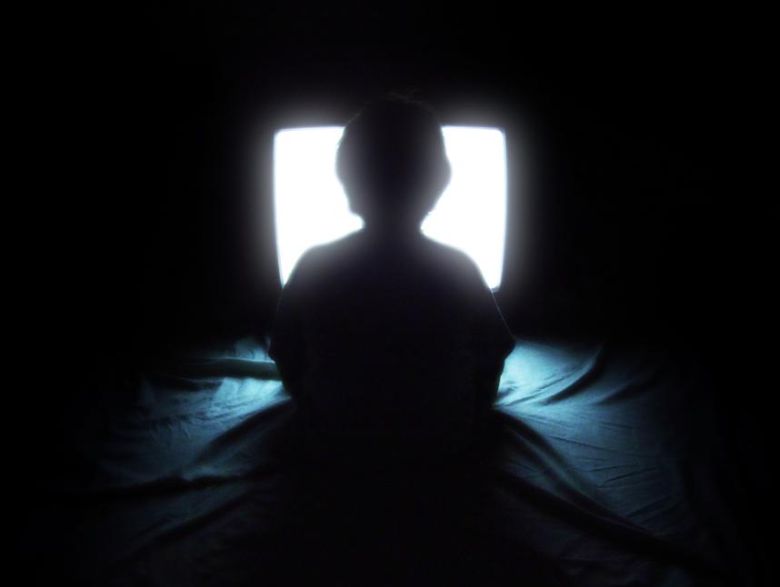 kids watching tv at night. watching tv in bed at night. kids tv night g