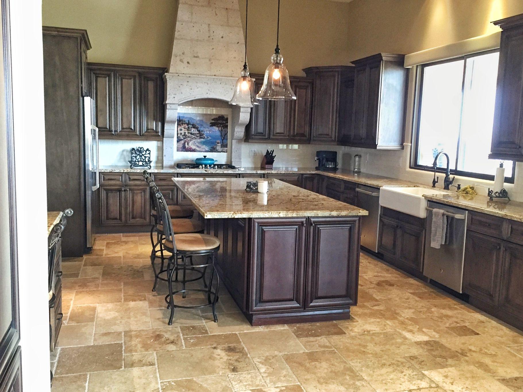 Raised panel rustic wood cabinets, granite countertops ...