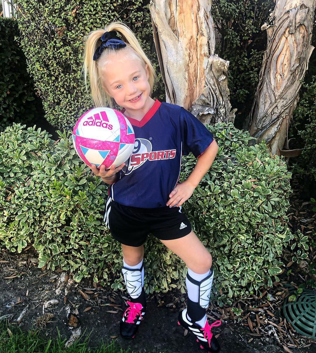 Image May Contain 1 Person Standing Shoes Shorts Child Outdoor And Nature Everleigh Rose Soccer Girls Outfits Soccer Outfits