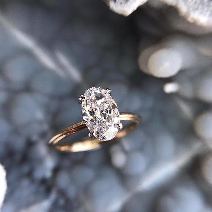 17 Minimalist Oval diamond cut engagement ring