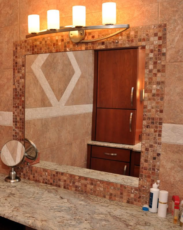 Tile frame around bathroom mirror - love this tile - reminds me of ...