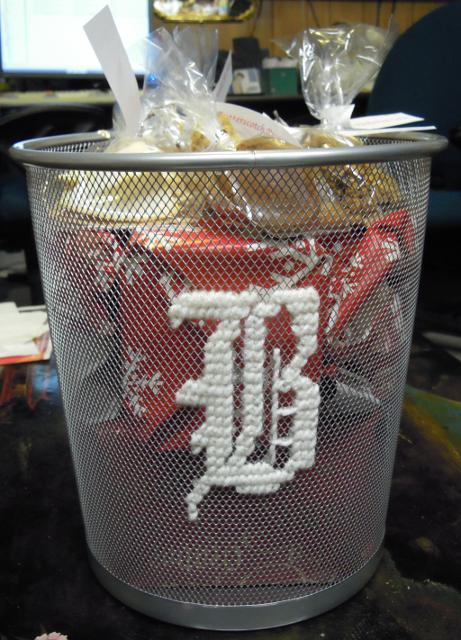 cross stitch. yarn on mesh trash can.