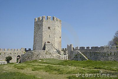 Platamonas medieval castle tower in Greece green grass