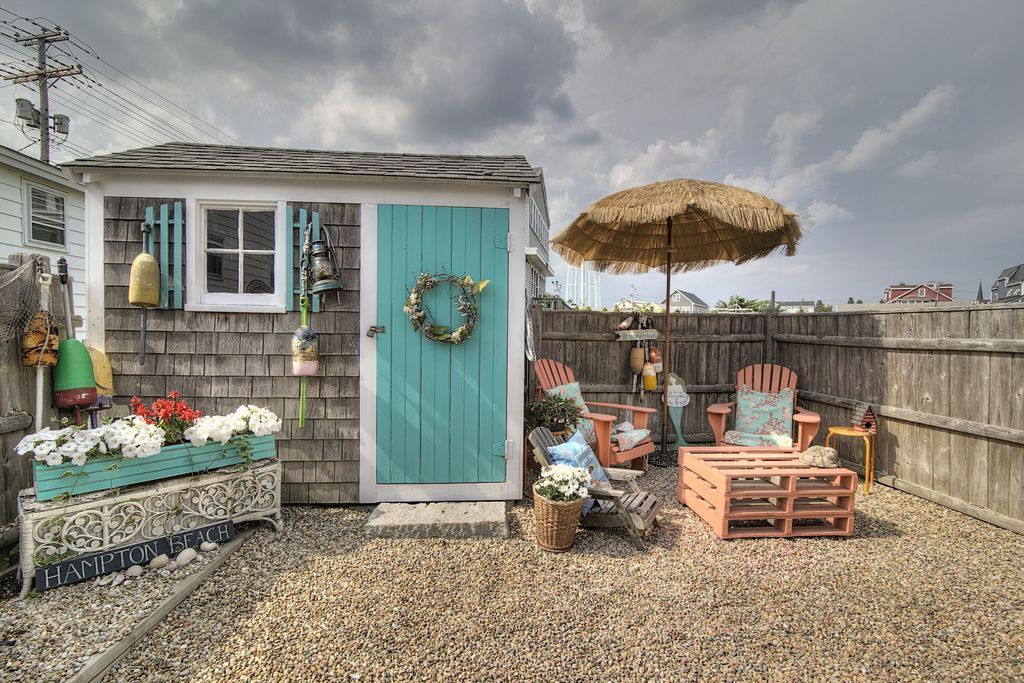 view this great cottage patio with outdoor umbrella garden shed in hampton nh the home was built in 1920 and is 788 square feet