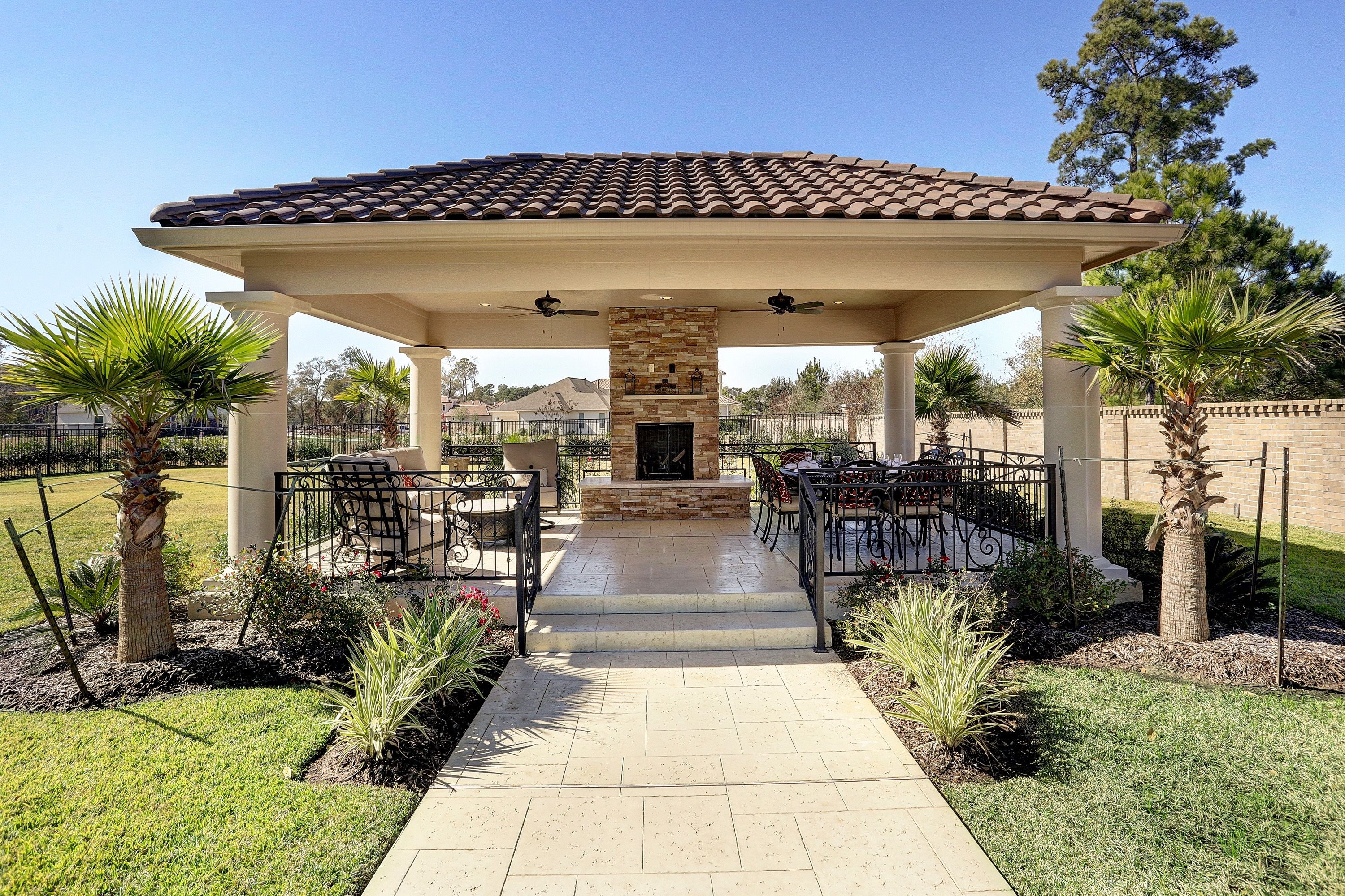 Free Standing Patio Outdoor Living Wrought Iron Railing Outdoor Fireplace Adobe Tile Outdoor Kitchen Pergola Patio Design Pergola Patio