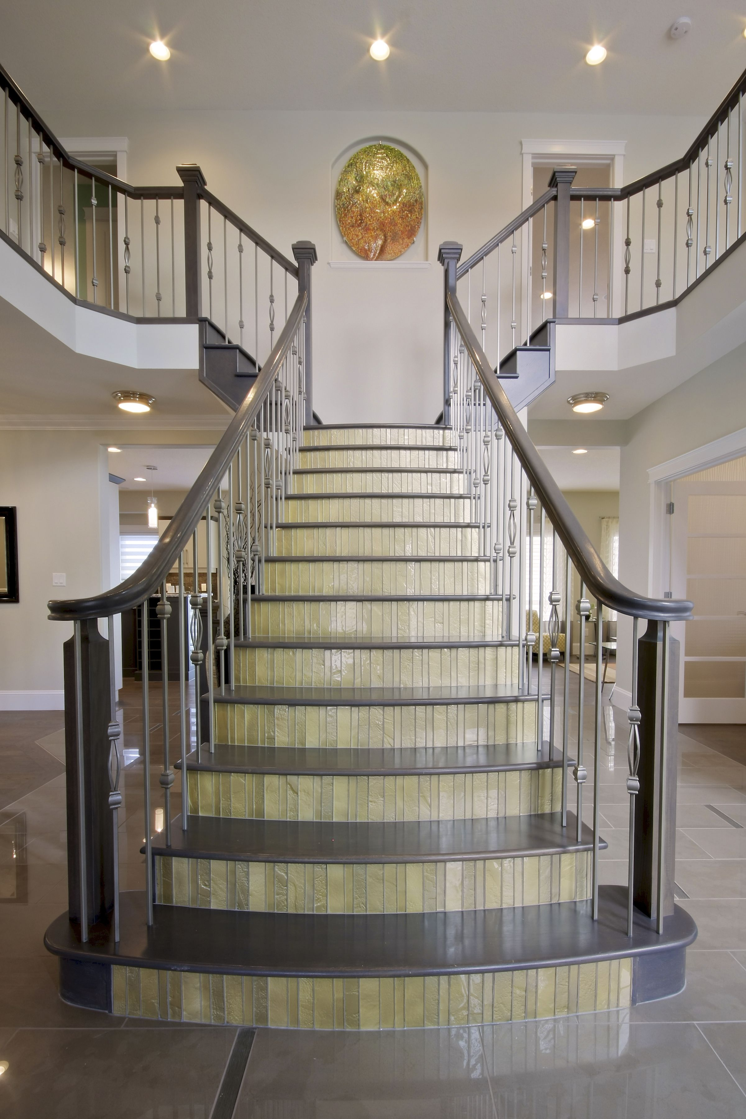 Make a grand entrance with this stunning, split staircase ...