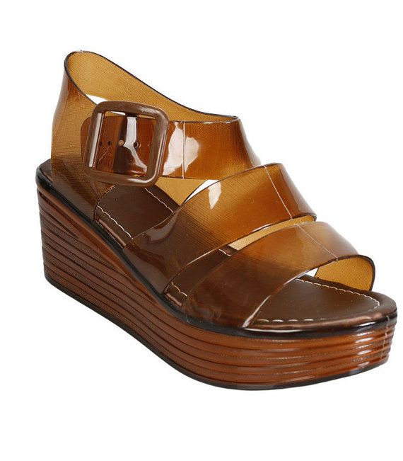 d9ecfad21e65 This open-toe platform jelly sandal is the perfect blend between vintage  and 90s greatness! You can pair it with some pastel socks or white thigh