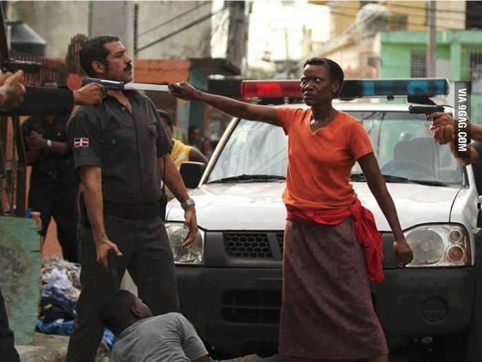 Haitian mother protecting her son