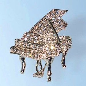 Grand Piano Pin White Diamond-like Swarovski Crystals Brooch Musical Pianist ... Dazzlers. $29.95. Bonded Seller, Stocked On Site, Quick Delivery & Gift Wrapping is optional.. Exquisite, limited edition item which is sure to grow in value over time.. 100% Satisfaction Guaranteed Or Your Money Back. Arrives In Padded Presentation Box With Certificate Of Authenticity. Each pin is hand set with Sparkling Swarovski Crystals & hand enameled.