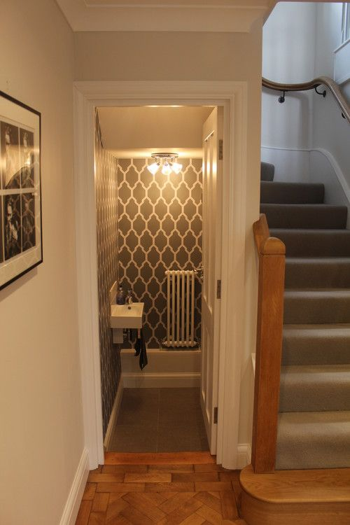 Here is a bathroom located under a half landing staircase for Bathroom designs under stairs