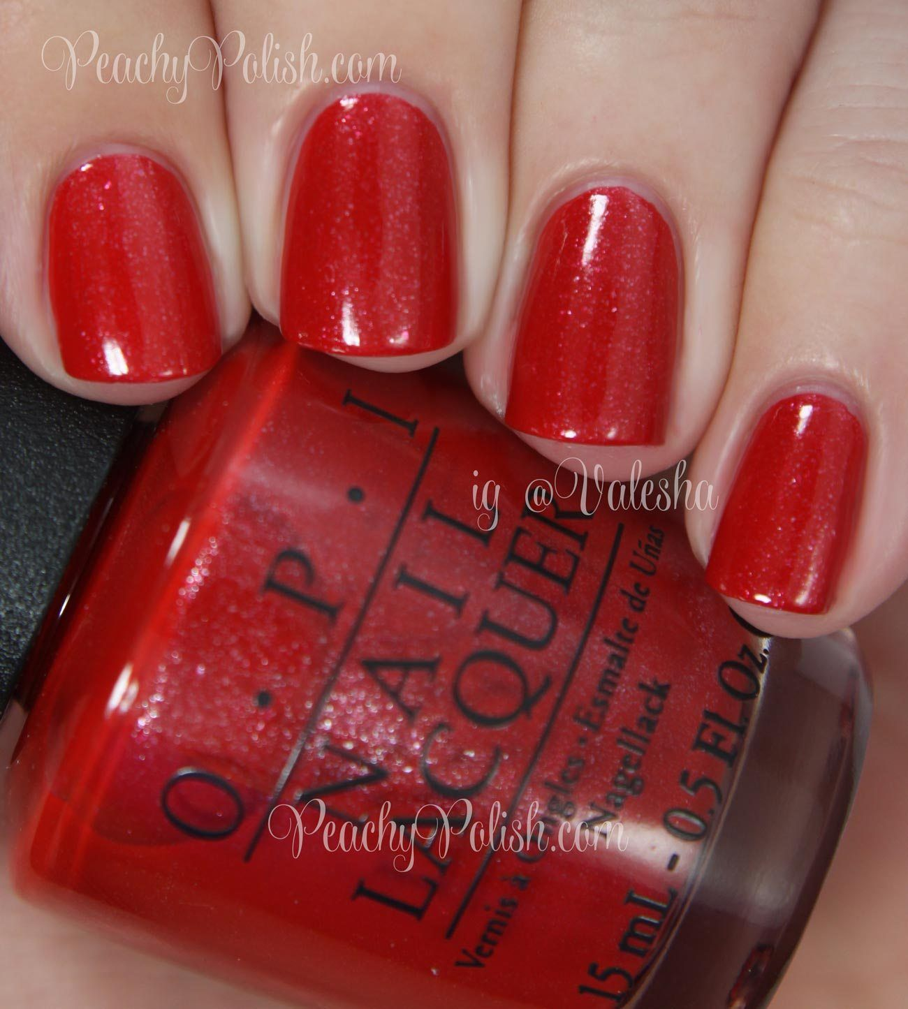Opi Love Athletes In Cleats Is A Blue Toned Red With Silver Shimmer